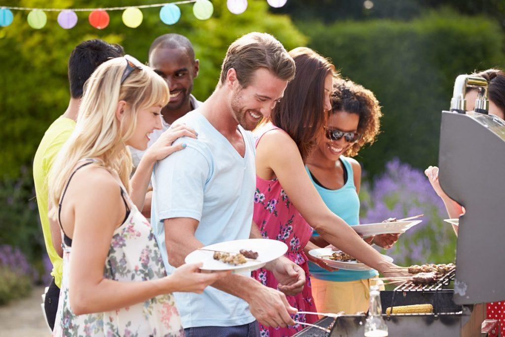 Friends having backyard barbecue
