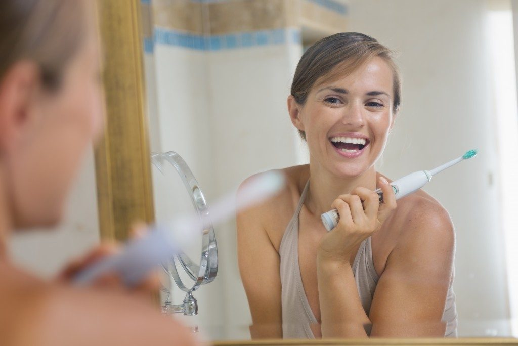 Woman smiling in front of the mirror