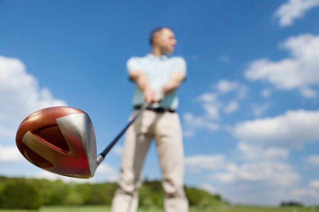 Golfer with a drive club