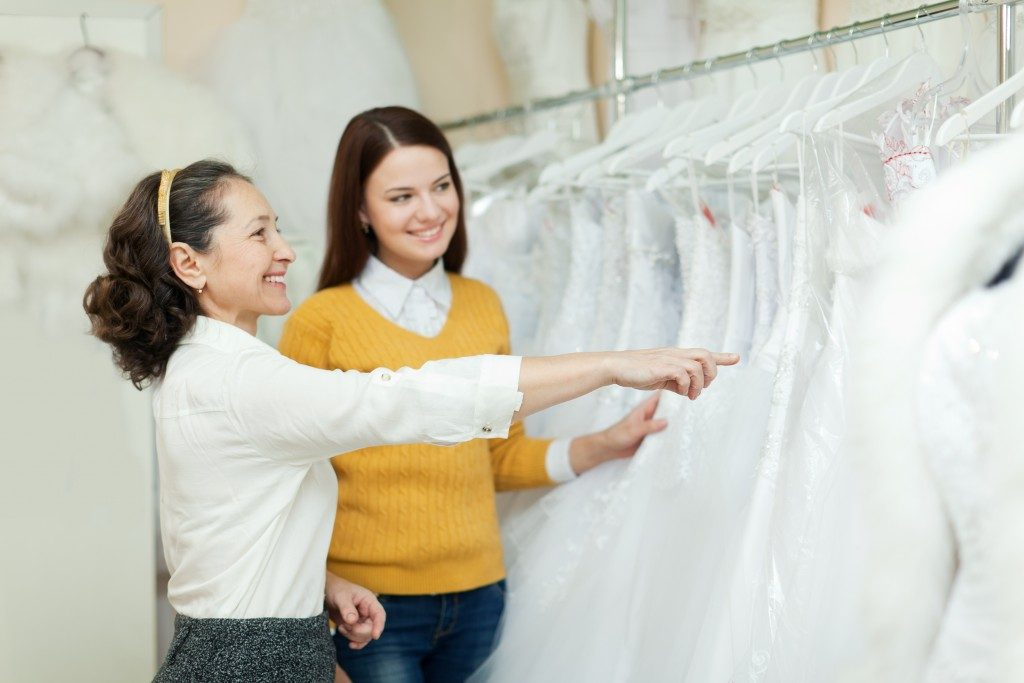 woman choosing bridal gown