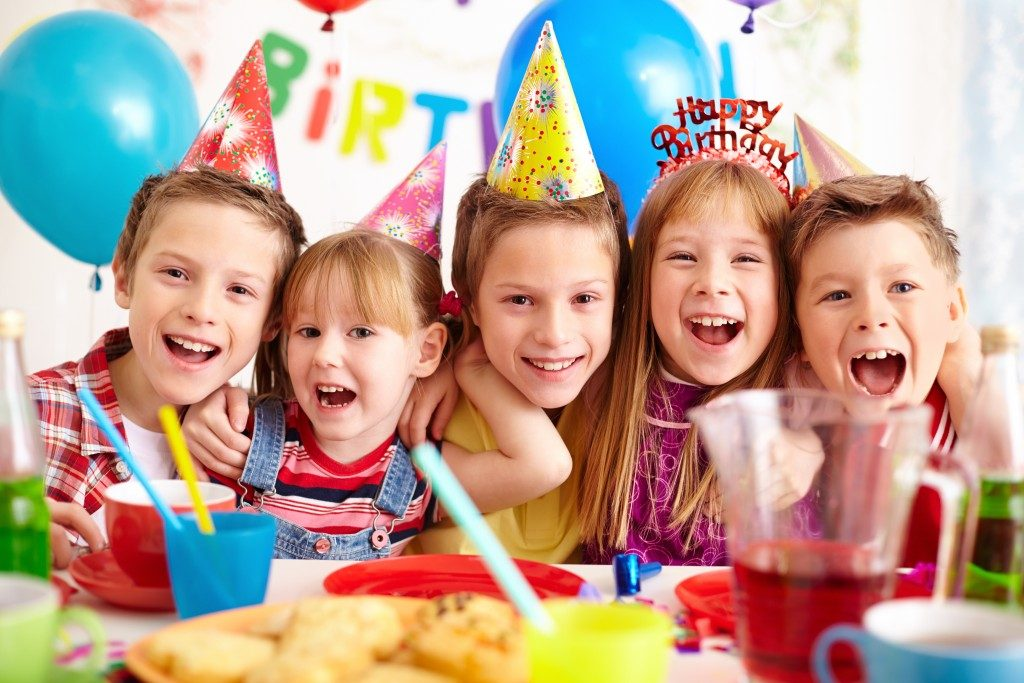 Kids waring party hats at a birthday celebration