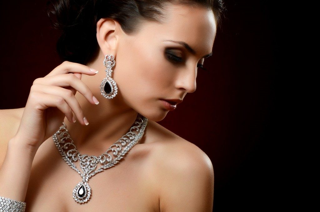 Woman in expensive pendant close-up