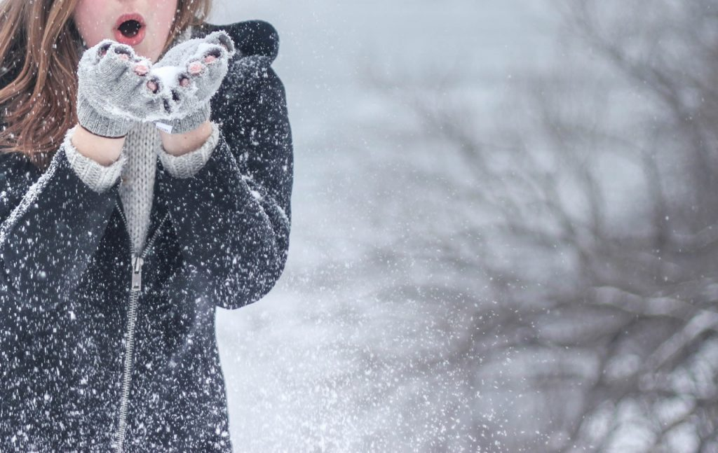 woman playingwith snow