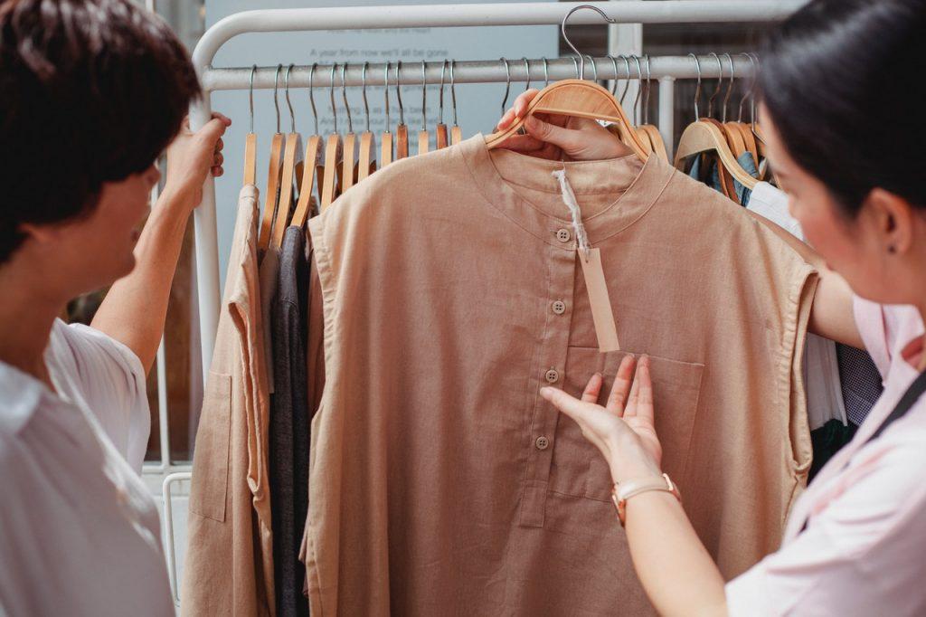 choosing a blouse to buy