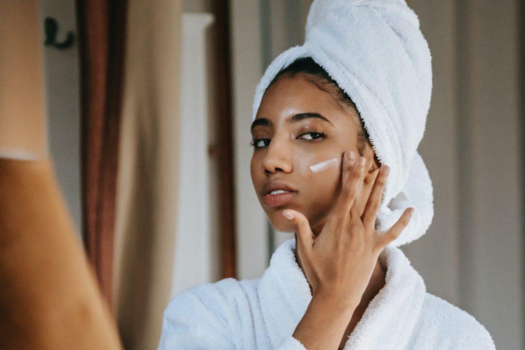 woman applying facial product