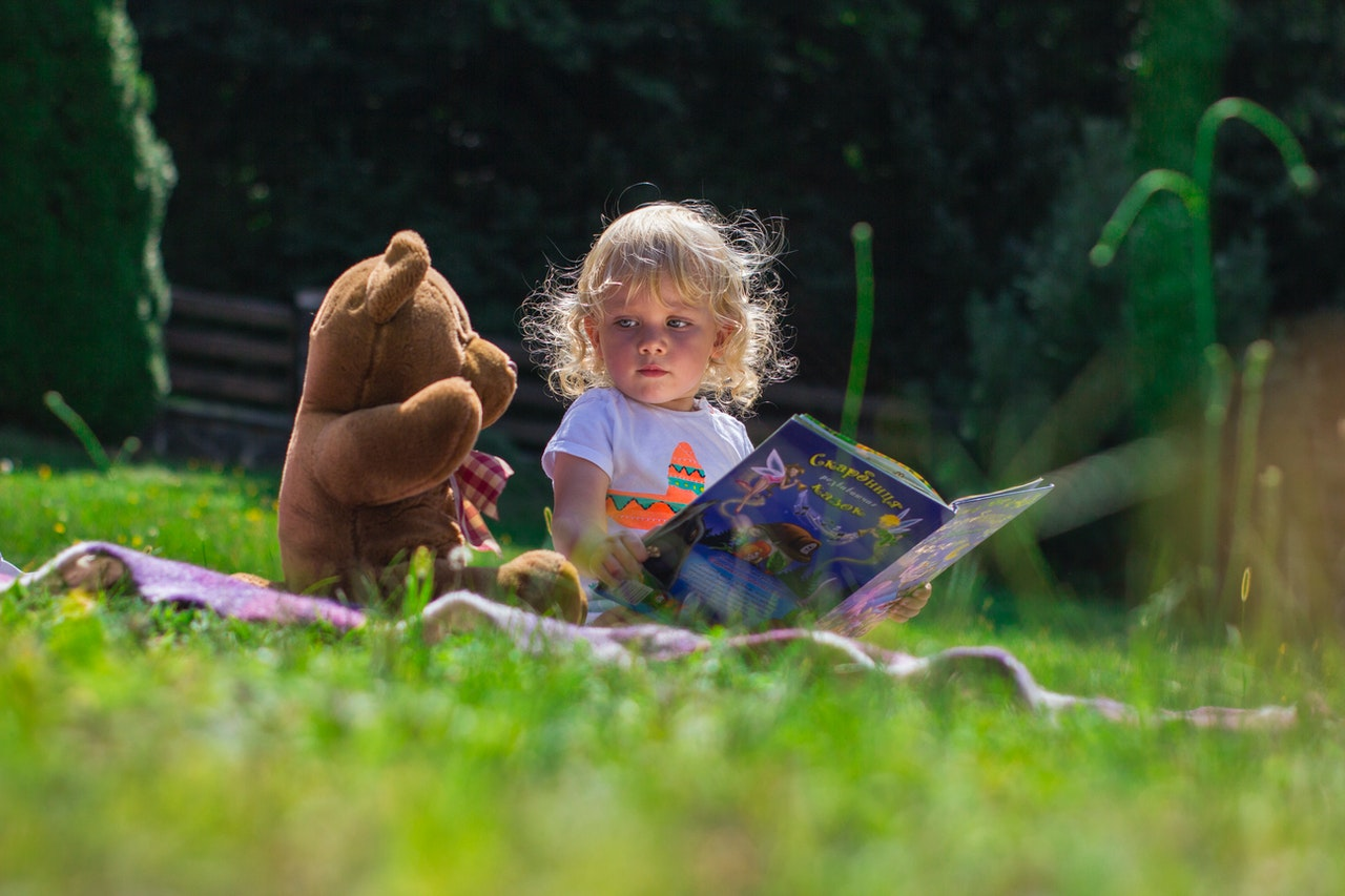 baby having a picnic with her teddy bear