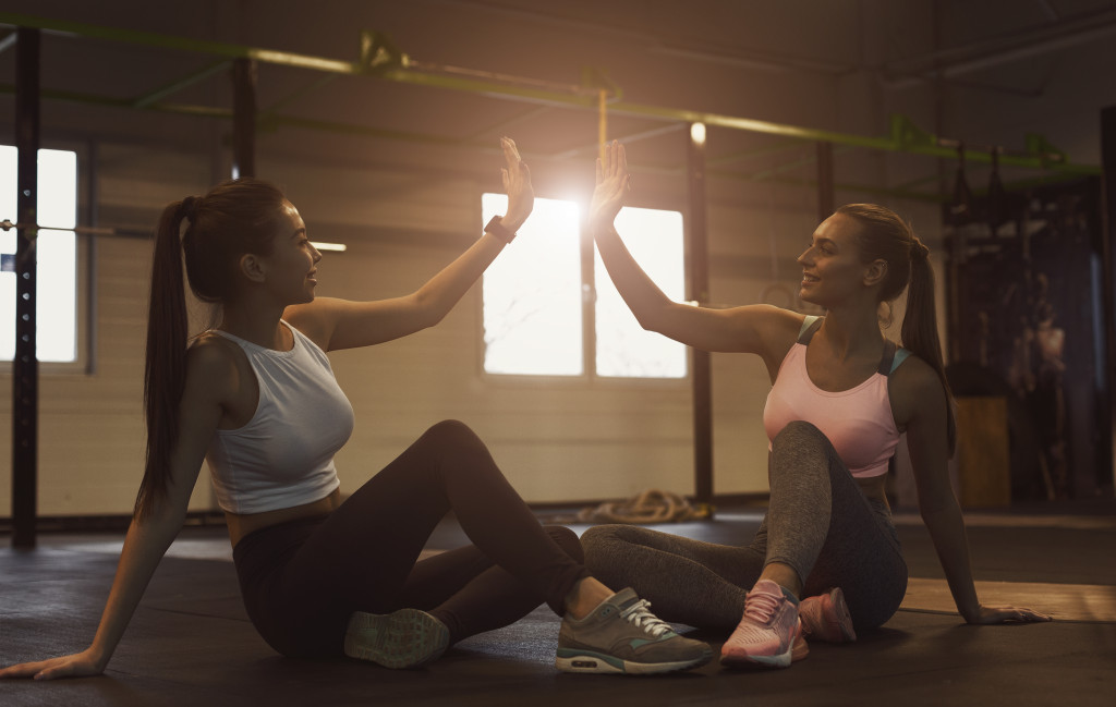 two woman exercising